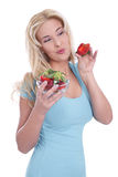 Isolated woman holding strawberries Royalty Free Stock Photo