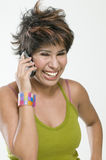 Isolated Woman talking on cellphone. Isolated woman short hair talking on cellphone Royalty Free Stock Image