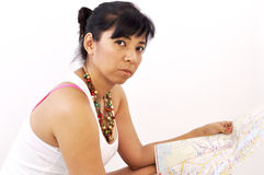 Isolated woman white top reads map Stock Photos