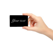 Isolated womans hand holding a black card Royalty Free Stock Photo