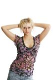 Isolated women. The blond fine girl poses on a white background Stock Photography