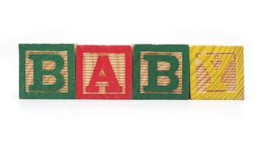 Isolated Wood Blocks. Isolated Wood Alphabet Blocks Spell the Word BABY Royalty Free Stock Photo