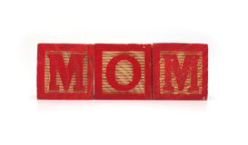 Isolated Wood Blocks. Isolated Wood Alphabet Blocks Spell the Word MOM Royalty Free Stock Photography