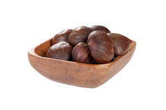 Isolated wood bowl of chestnuts Stock Photo