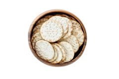 Isolated Bowl of Water Crackers. Isolated wooden bowl of water crackers over a white background. Clipping path included. Image shot from overhead stock images