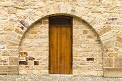 Free Isolated Wooden Door In A Brick Wall With A Rounded Arch Prague, Czech Republic Stock Image - 169095421