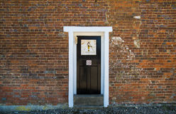 Isolated wooden door Stock Photography