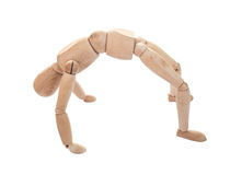 Isolated wooden figure on back bend pose Royalty Free Stock Photo