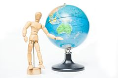 Isolated wooden figure with globe on white background,welcome to Stock Photo