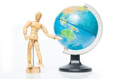 Isolated wooden figure with globe on white background,welcome to Stock Images