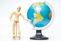 Isolated wooden figure with globe on white background,welcome to Stock Photos