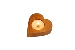 Isolated wooden heart candlestick with a candle Stock Images