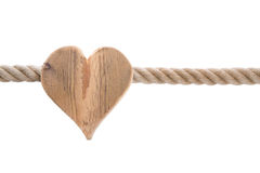 Isolated wooden heart with a ship rope isolated on white backgro Royalty Free Stock Photography