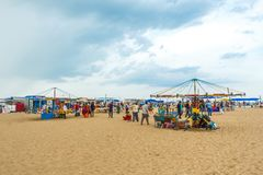 Isolated wooden horse ride swinger for kids with blue sky, dark clouds in the background,Marina beach,Chennai,India 19 aug 2017 Stock Photo