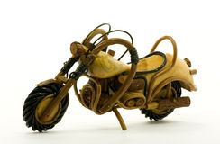 Isolated wooden motorcycle model Royalty Free Stock Photography
