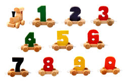 Isolated wooden numbers. Isolated wooden educational toys trains of number nil to nine on the wheels stock photos