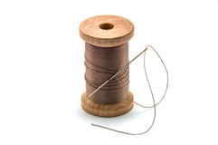 Isolated wooden spool of brown thread Royalty Free Stock Photography
