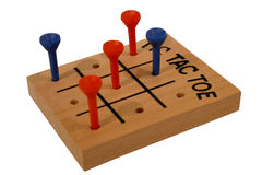 Isolated wooden tic-tac-toe game. On white background royalty free stock photos