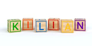 Isolated wooden toy cubes with letters with name killian. Isolated wooden toy cubes with letters with name Louis 3D Illustration Stock Photos