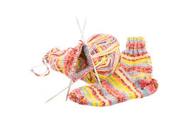 Isolated woolen socks with knitting equipment Royalty Free Stock Photos