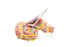 Isolated woolen socks with knitting equipment Stock Images