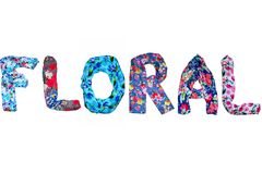 Isolated word floral is lined with various clothes with bright floral print stock photos
