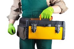 Isolated worker in green overall outfit with toolbox royalty free stock image