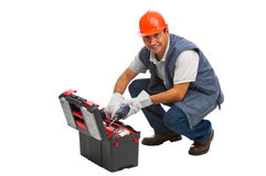 Isolated worker looking for a drill Stock Image