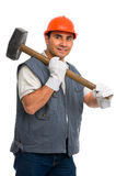 Isolated worker using a big metal mallet. Portrait isolated worker using a big metal mallet Royalty Free Stock Photography