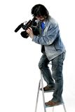 Isolated working cameraman Royalty Free Stock Image