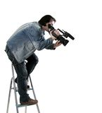 Isolated working cameraman. Isolated cameraman work with dv handy camcorder from the step-ladder Stock Images