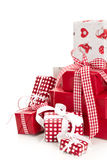 Isolated wrapped red Christmas presents. With checked and white ribbon Stock Photography