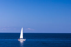 Isolated Yacht in the blue sea Stock Photos