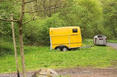 Isolated yellow caravan in the forest Germany, Europe stock photo