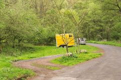 Isolated yellow caravan in the forest Germany, Europe royalty free stock photo