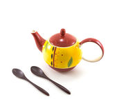 Isolated Yellow Ceramic Tea Pot with Two Wooden Spoons on White. Background Royalty Free Stock Photo