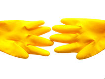 Isolated yellow gloves. Close up. Isolated yellow gloves on white background Royalty Free Stock Images