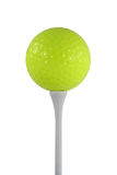 Isolated yellow golf ball on a white tee Royalty Free Stock Photos
