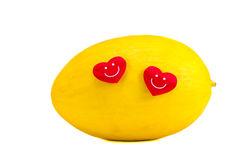 Isolated yellow melon with two red hearts Royalty Free Stock Photography