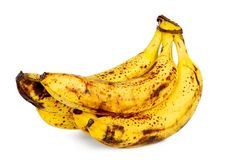 Yellow over ripe bananas stock images