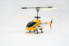 Isolated Yellow Remote Controlled Helicopter. Yellow Remote Control Helicopter on White Background Royalty Free Stock Photos