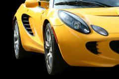 Isolated yellow sports car on black. A Isolated yellow sports car on black Royalty Free Stock Images
