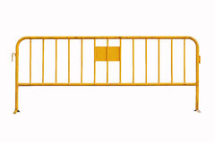 Isolated yellow temporary fence Royalty Free Stock Photo