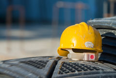 Isolated yellow worker hard-hat,natural light in construction si Royalty Free Stock Images