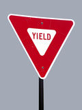 Isolated Yield Sign. A high quality metal yield sign close up image royalty free stock photos