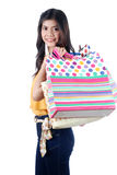 Isolated Yong Asian Woman With colorful Shopping Bags Royalty Free Stock Photo