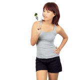 Young asian woman with a picec of brocolli Royalty Free Stock Photos