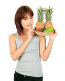 Young asian woman with variety of oriental fruits. Stock Photos