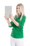 Isolated young attractive blond woman holding tablet pc. Stock Image