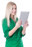 Isolated young attractive blond woman holding tablet pc. Royalty Free Stock Photos
